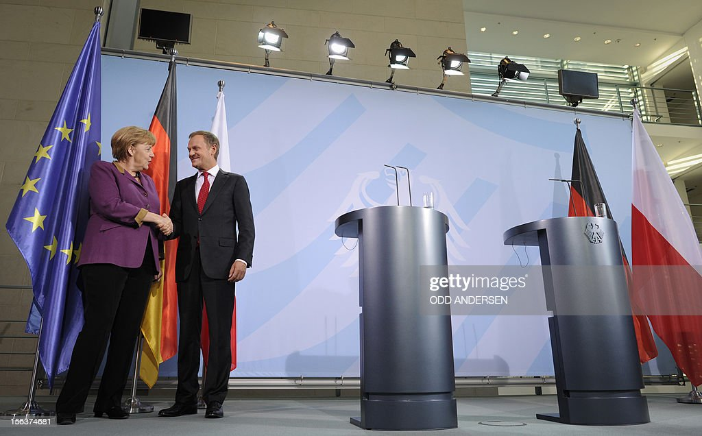German Chancellor Angela Merkel (L) and Polish Prime Minister Donald Tusk (R)shake hands after a press conference following the signature of an agreement between their countries at the Chancellery in Berlin on November 14, 2012. Merkel and Tusk held talks focused on the forthcoming EU summit on the bloc's seven-year budget.