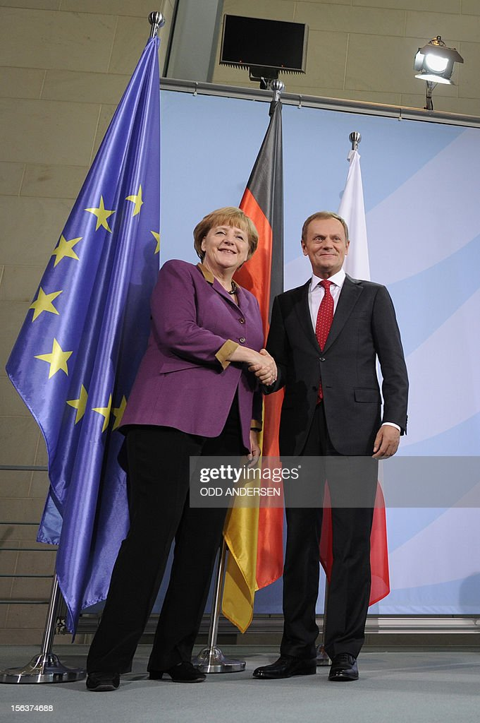 German Chancellor Angela Merkel (L) and Polish Prime Minister Donald Tusk (R) shake hands after a press conference following the signature of an agreement between their countries at the Chancellery in Berlin on November 14, 2012. Merkel and Tusk held talks focused on the forthcoming EU summit on the bloc's seven-year budget.