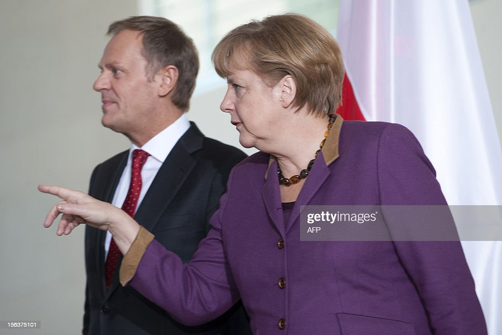 German Chancellor Angela Merkel and Polish Prime Minister Donald Tusk arrive to address the press after German-Polish governmental consultations on November 14, 2012 at the Chancellery in Berlin. Merkel and Tusk met for talks focused on the forthcoming EU summit on the bloc's seven-year budget.