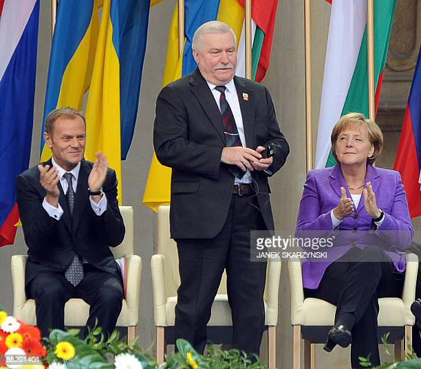 German Chancellor Angela Merkel and Polish Prime Minister Donald Tusk applaud former Polish President Lech Walesa the iconic Solidarity union leader...