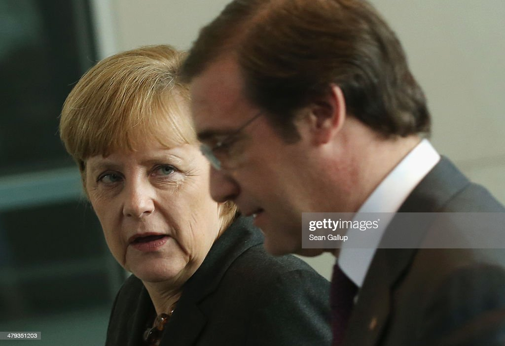German Chancellor <a gi-track='captionPersonalityLinkClicked' href=/galleries/search?phrase=Angela+Merkel&family=editorial&specificpeople=202161 ng-click='$event.stopPropagation()'>Angela Merkel</a> and Portuguese Prime Minister <a gi-track='captionPersonalityLinkClicked' href=/galleries/search?phrase=Pedro+Passos+Coelho&family=editorial&specificpeople=6912340 ng-click='$event.stopPropagation()'>Pedro Passos Coelho</a> depart after speaking to the media following bilateral talks at the Chancellery on March 18, 2014 in Berlin, Germany. Merkel praised Portugal's reform efforts since the European financial crisis.