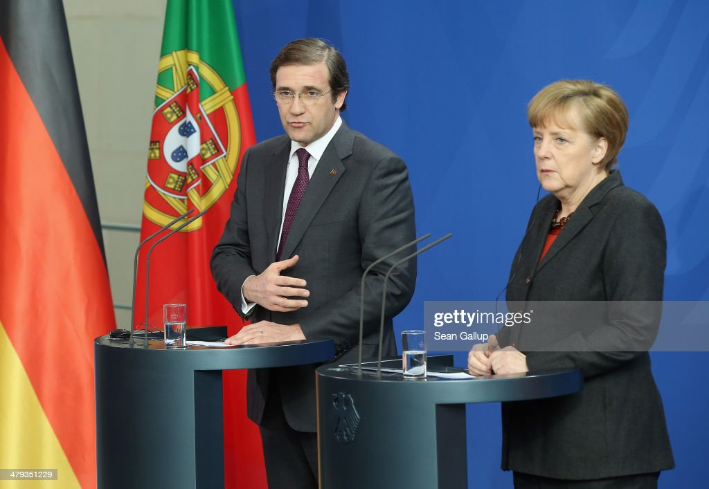 German Chancellor Angela Merkel and Portuguese Prime Minister <a gi-track='captionPersonalityLinkClicked' href=/galleries/search?phrase=Pedro+Passos+Coelho&family=editorial&specificpeople=6912340 ng-click='$event.stopPropagation()'>Pedro Passos Coelho</a> speak to the media following bilateral talks at the Chancellery on March 18, 2014 in Berlin, Germany. Merkel praised Portugal's reform efforts since the European financial crisis.