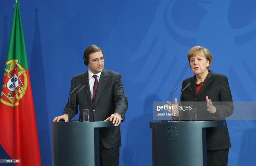 German Chancellor <a gi-track='captionPersonalityLinkClicked' href=/galleries/search?phrase=Angela+Merkel&family=editorial&specificpeople=202161 ng-click='$event.stopPropagation()'>Angela Merkel</a> and Portuguese Prime Minister <a gi-track='captionPersonalityLinkClicked' href=/galleries/search?phrase=Pedro+Passos+Coelho&family=editorial&specificpeople=6912340 ng-click='$event.stopPropagation()'>Pedro Passos Coelho</a> speak to the media following bilateral talks at the Chancellery on March 18, 2014 in Berlin, Germany. Merkel praised Portugal's reform efforts since the European financial crisis.