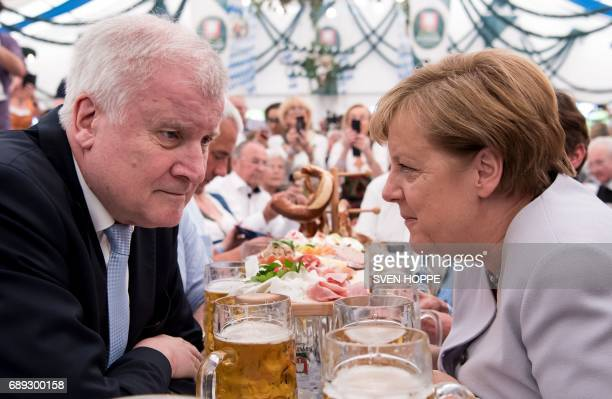 German Chancellor Angela Merkel and premier of the German state of Bavaria Horst Seehofer sit in a beer tent during a joint campaigning event of the...