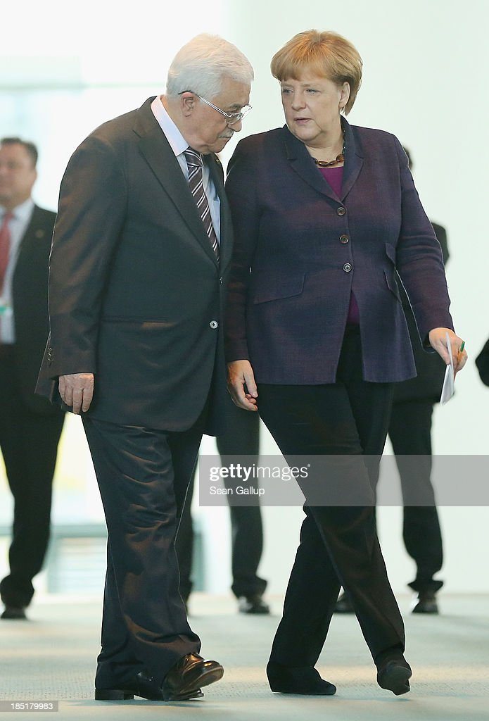 German Chancellor Angela Merkel and President of the Palestinian National Authority Mahmoud Abbas arrive to speak to the media following talks at the Chancellery on October 18, 2013 in Berlin, Germany. Abbas is currently in Europe partly to lobby the European Union against providing Israel funds for housing expansion in occupied territories.
