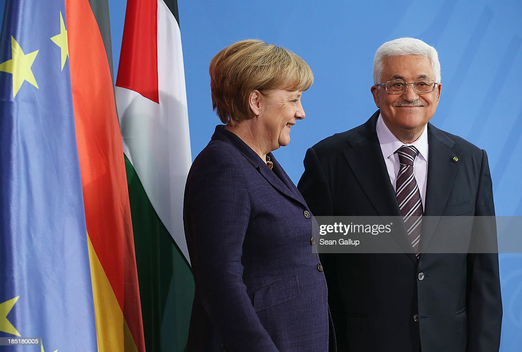 German Chancellor <a gi-track='captionPersonalityLinkClicked' href=/galleries/search?phrase=Angela+Merkel&family=editorial&specificpeople=202161 ng-click='$event.stopPropagation()'>Angela Merkel</a> and President of the Palestinian National Authority <a gi-track='captionPersonalityLinkClicked' href=/galleries/search?phrase=Mahmoud+Abbas&family=editorial&specificpeople=176534 ng-click='$event.stopPropagation()'>Mahmoud Abbas</a> depart after speaking to the media following talks at the Chancellery on October 18, 2013 in Berlin, Germany. Abbas is currently in Europe partly to lobby the European Union against providing Israel funds for housing expansion in occupied territories.