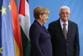 German Chancellor Angela Merkel and President of the Palestinian National Authority Mahmoud Abbas depart after speaking to the media following talks...