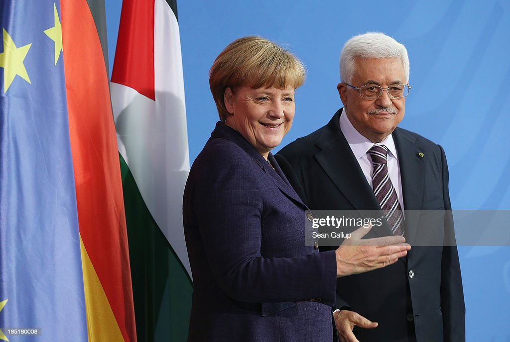 German Chancellor Angela Merkel and President of the Palestinian National Authority Mahmoud Abbas depart after speaking to the media following talks at the Chancellery on October 18, 2013 in Berlin, Germany. Abbas is currently in Europe partly to lobby the European Union against providing Israel funds for housing expansion in occupied territories.