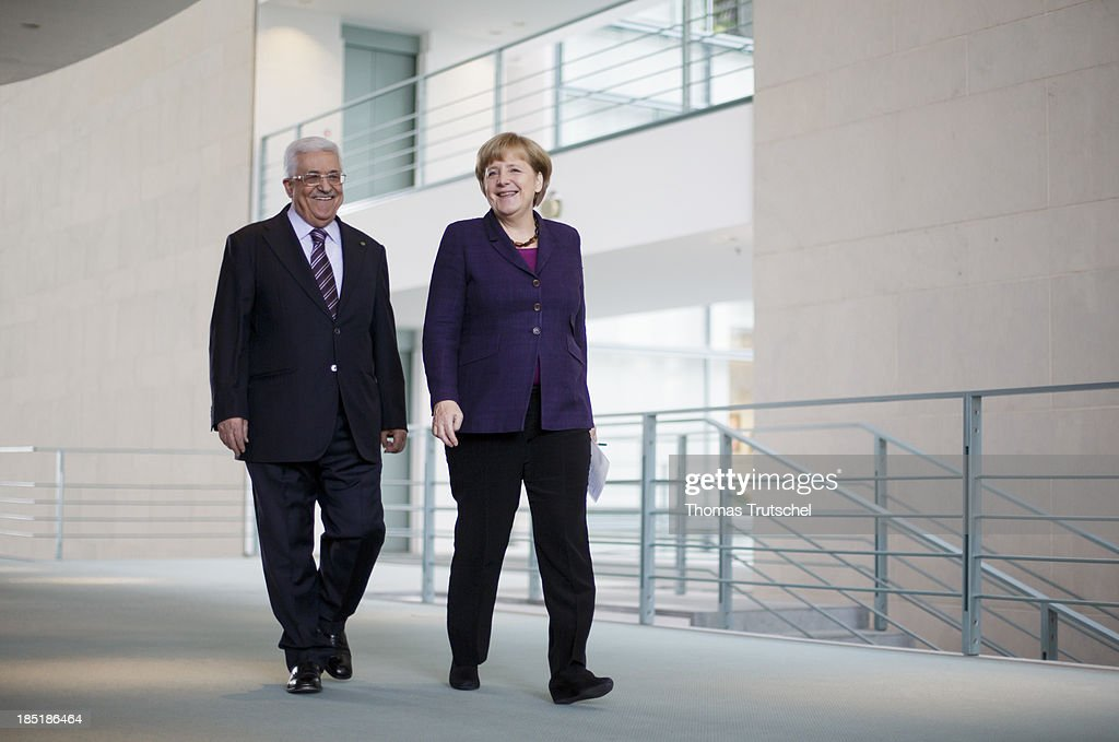German Chancellor <a gi-track='captionPersonalityLinkClicked' href=/galleries/search?phrase=Angela+Merkel&family=editorial&specificpeople=202161 ng-click='$event.stopPropagation()'>Angela Merkel</a> and President of the Palestinian National Authority <a gi-track='captionPersonalityLinkClicked' href=/galleries/search?phrase=Mahmoud+Abbas&family=editorial&specificpeople=176534 ng-click='$event.stopPropagation()'>Mahmoud Abbas</a> arrive to speak to the media following talks at the Chancellery on October 18, 2013 in Berlin, Germany. Abbas is currently in Europe partly to lobby the European Union against providing Israel funds for housing expansion in occupied territories.