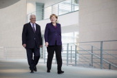 German Chancellor Angela Merkel and President of the Palestinian National Authority Mahmoud Abbas arrive to speak to the media following talks at the...
