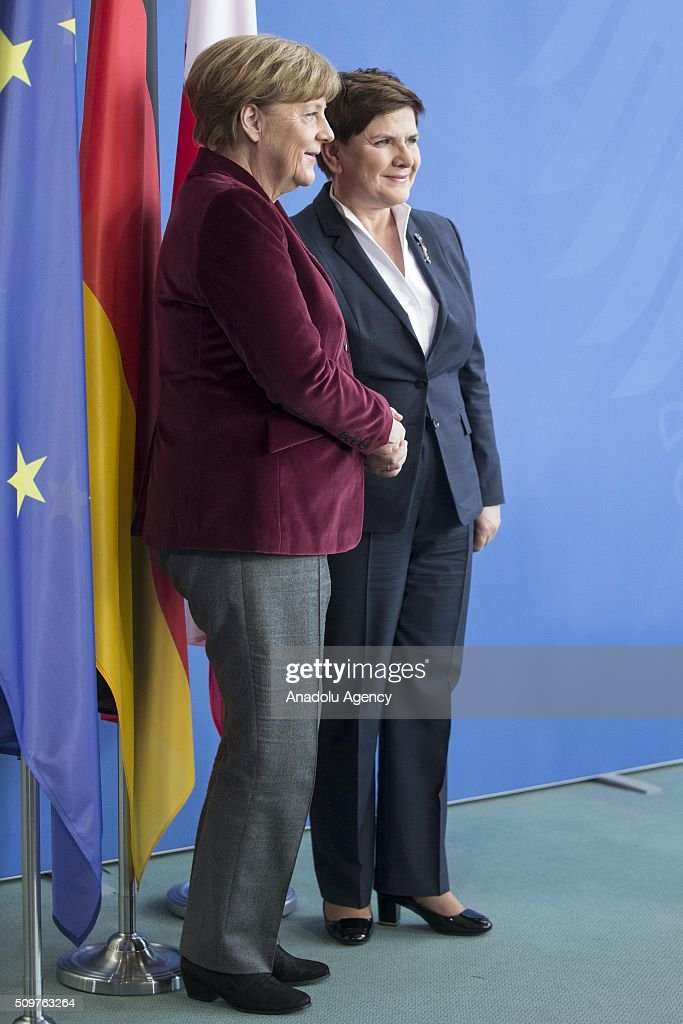 German Chancellor Angela Merkel (L) and Prime Minister of Poland Beata Szydlo (R) shake hands of each other during a joint press conference after their meeting at German Chancellery in Berlin, Germany on February 12, 2016.