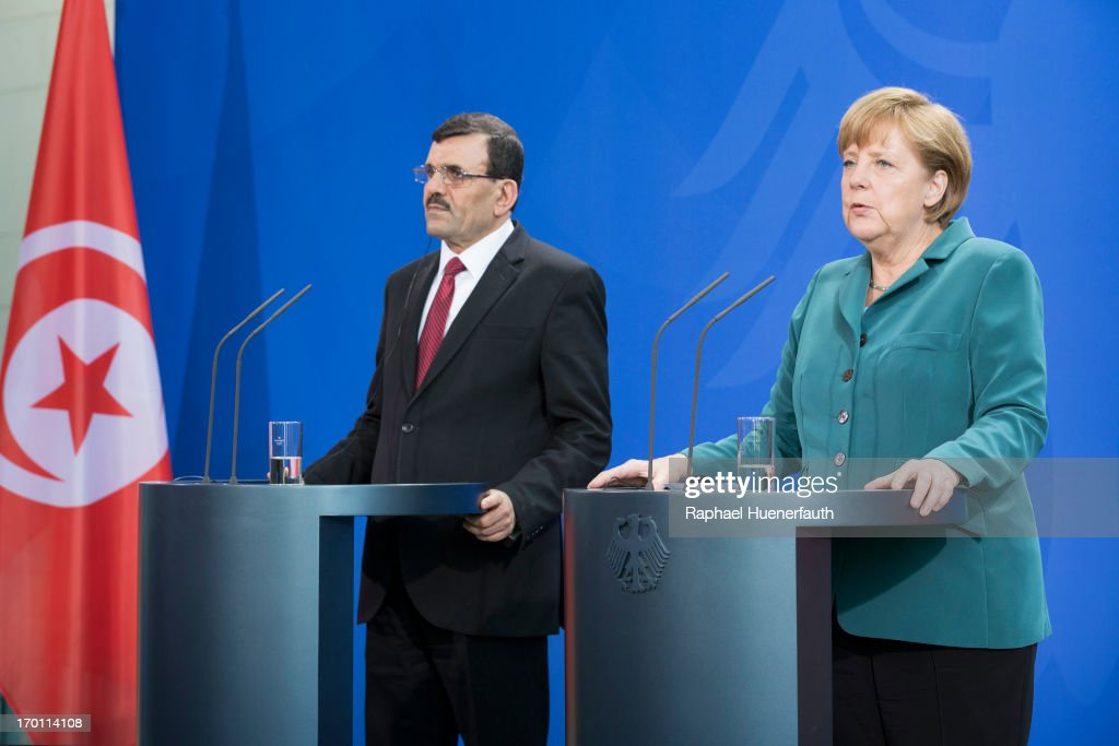 German Chancellor <a gi-track='captionPersonalityLinkClicked' href=/galleries/search?phrase=Angela+Merkel&family=editorial&specificpeople=202161 ng-click='$event.stopPropagation()'>Angela Merkel</a> and Prime Minister of Tunisia Ali Laarayedh gives a joint press conference on June 07, 2013 at the Federal Chancellery in Berlin, Germany.