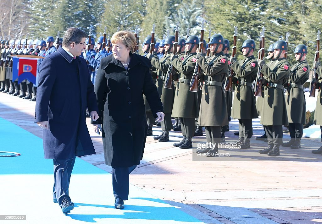 German Chancellor Angela Merkel (Front R) and Prime Minister of Turkey Ahmet Davutoglu (L) inspect the honor guards during the official welcoming ceremony in Ankara, Turkey on February 8, 2016.