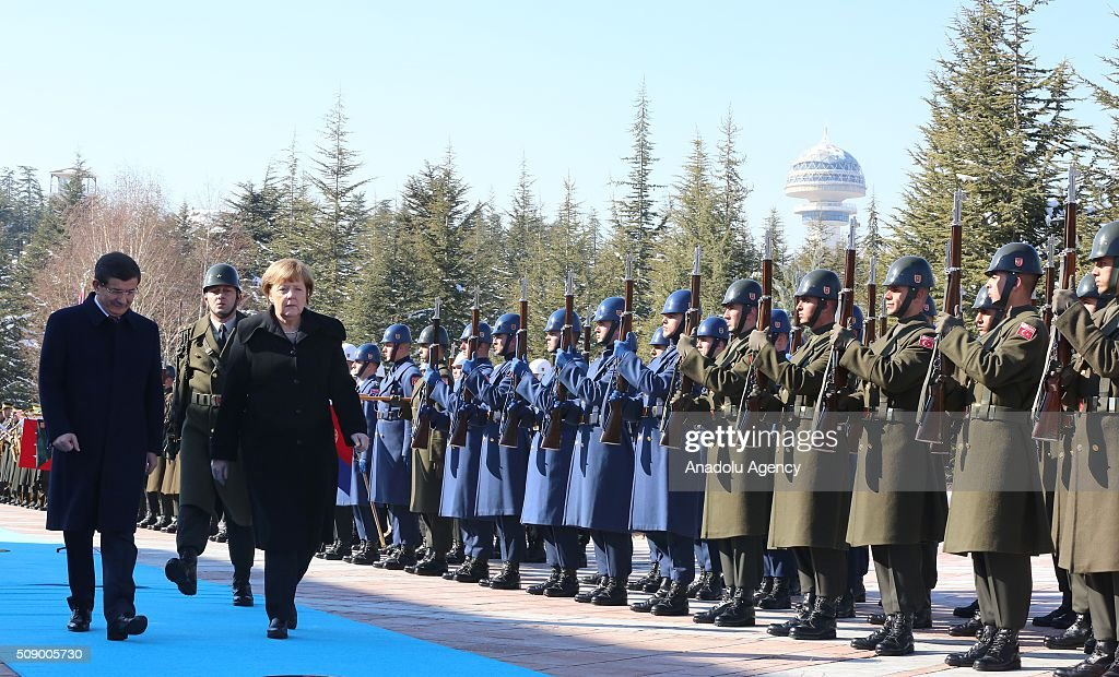 German Chancellor Angela Merkel (Front R) and Prime Minister of Turkey Ahmet Davutoglu (L) inspects the honor guards during the official welcoming ceremony in Ankara, Turkey on February 8, 2016.