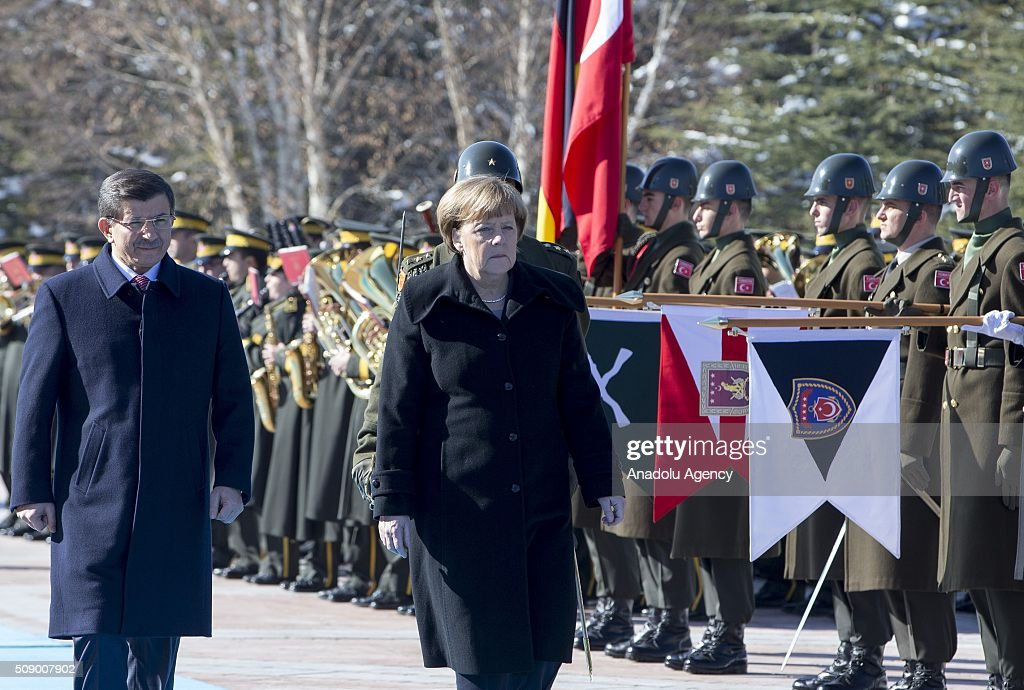 German Chancellor Angela Merkel (R) and Prime Minister of Turkey Ahmet Davutoglu (L) inspect the honor guards during the official welcoming ceremony in Ankara, Turkey on February 8, 2016.
