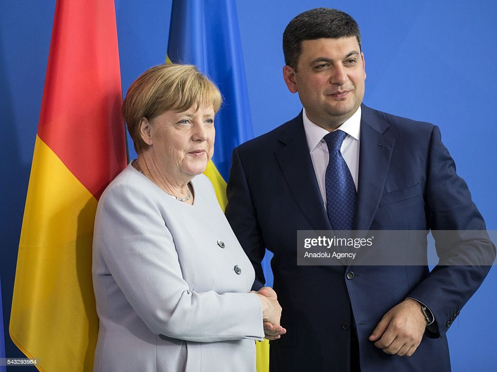 German Chancellor Angela Merkel (L) and Prime Minister of Ukraine Volodymyr Groysman (R) shakes hands during a press conference after their meeting at the Prime Minister's office in Berlin, Germany on June 27, 2016.
