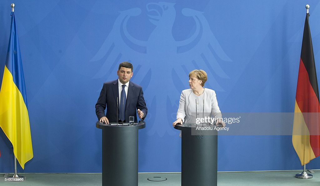 German Chancellor Angela Merkel (R) and Prime Minister of Ukraine Volodymyr Groysman (L) hold a press conference after their meeting at the Prime Minister's office in Berlin, Germany on June 27, 2016.