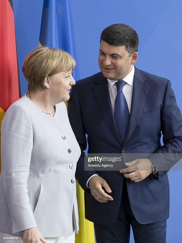 German Chancellor Angela Merkel (L) and Prime Minister of Ukraine Volodymyr Groysman (R) talk each other during a press conference after their meeting at the Prime Minister's office in Berlin, Germany on June 27, 2016.