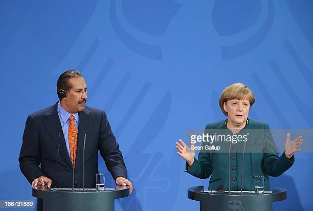 German Chancellor Angela Merkel and Qatar Prime Minister Hamad bin Jassim Al Thani speak to the media following talks at the Chancellery on April 16...