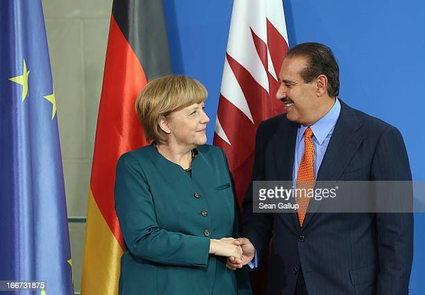 German Chancellor Angela Merkel and Qatar Prime Minister Hamad bin Jassim Al Thani depart after speaking to the media following talks at the...