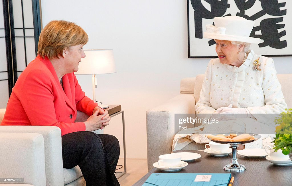 German Chancellor Angela Merkel and Queen Elizabeth II speak during their meeting at the Federal Chancellery on the second of the royal couple's four-day visit to Germany on June 24, 2015 in Berlin, Germany. The Queen and Prince Philip are scheduled to visit Berlin, Frankfurt and the concentration camp memorial at Bergen-Belsen during their trip, which is their first to Germany since 2004.