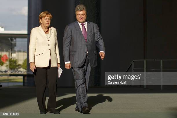 German Chancellor Angela Merkel and recentlyelected Ukrainian President Petro Poroshenko arrive to give statements to the media prior to talks at the...