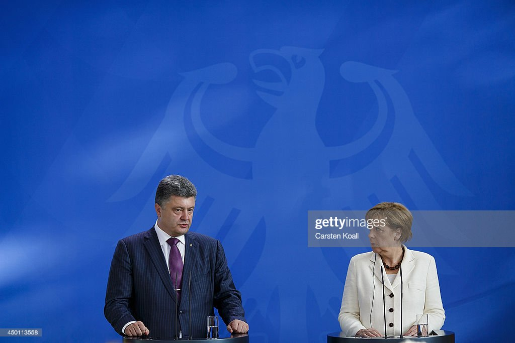 German Chancellor Angela Merkel and recently-elected Ukrainian President Petro Poroshenko give statements to the media prior to talks at the Chancellery on June 5, 2015 in Berlin, Germany. Poroshenko is meeting with western leaders as the situation in eastern Ukraine is descending further into war between government forces and Russian-backed separatists.