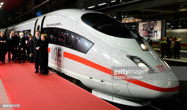 German Chancellor Angela Merkel and Richard Lutz chairman of German railway operator Deutsche Bahn pose next to an ICE high speed train after the...