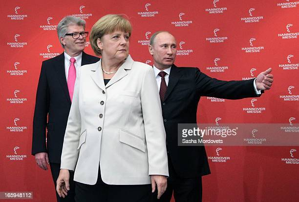 German Chancellor Angela Merkel and Russian President Vladimir Putin pose for a photo during the opening ceremony of the industrial exhibition...