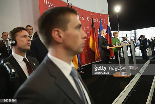 German Chancellor Angela Merkel and Russian President Vladimir Putin lspeak to the media after touring the Hannover Messe 2013 industrial trade fair...