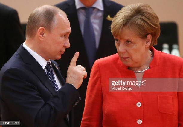 German Chancellor Angela Merkel and Russian President Vladimir Putin arrive to the plenary session at the G20 Summit on July 7 2017 in Hamburg Germany