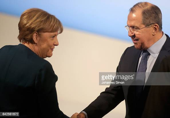 German Chancellor Angela Merkel and Sergey Lavrov Russian Minister of Foreign Affairs shake hands during bilateral meeting at the 2017 Munich...