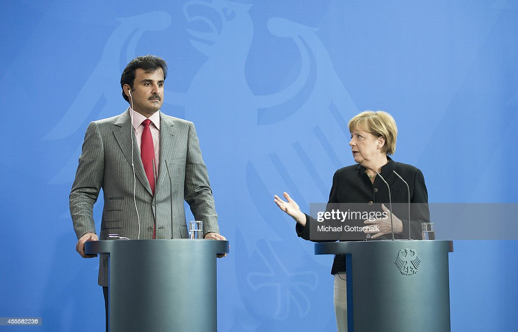 German Chancellor Angela Merkel and Sheikh Tamim bin Hamad Al Thani, the eighth and current Emir of the State of Qatar meet in chancellery on September 17, 2014 in Berlin, Germany. The Qatari monarch, known for his support of sporting events and his position as head of the Qatar Investment Authority board of directors, is visiting Berlin and Bavaria on his trip to the country.