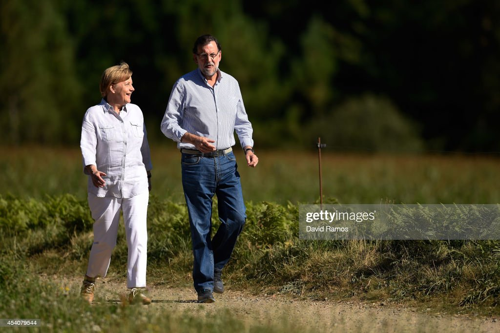 German Chancellor Angela Merkel and Spanish Prime Minister Mariano Rajoy walk a stretch of the Camino de Santiago as part of a two day summit on...