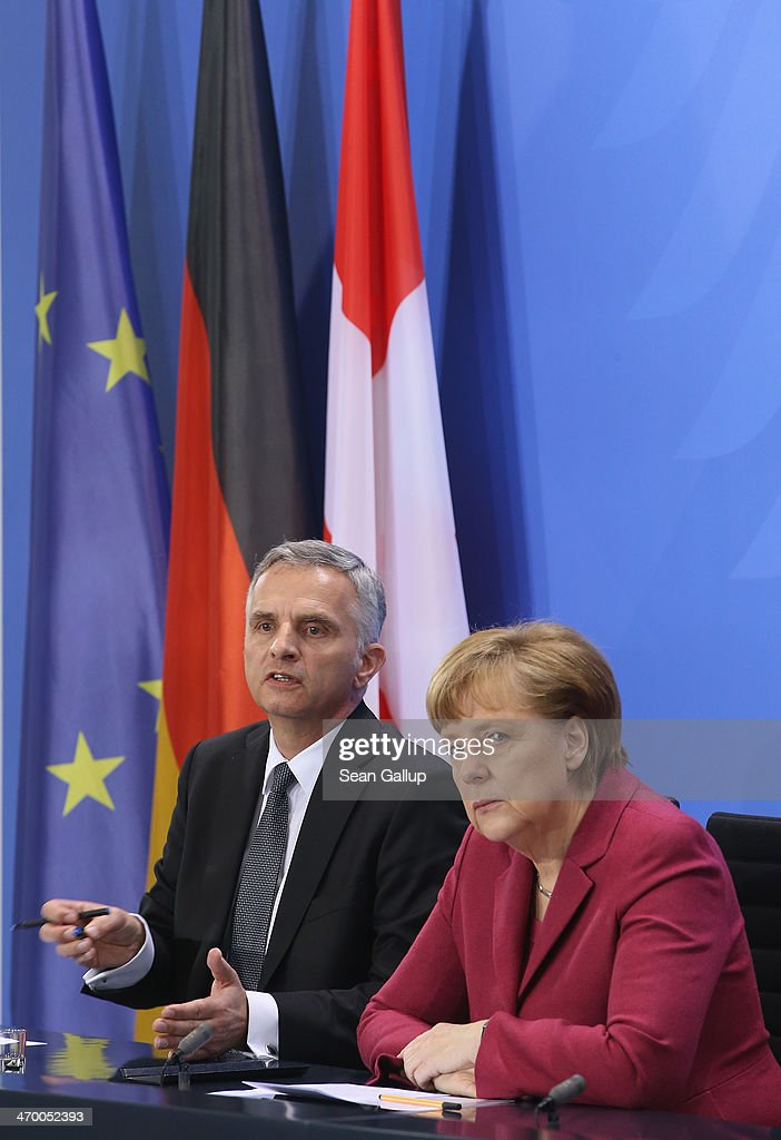 German Chancellor <a gi-track='captionPersonalityLinkClicked' href=/galleries/search?phrase=Angela+Merkel&family=editorial&specificpeople=202161 ng-click='$event.stopPropagation()'>Angela Merkel</a> and Swiss President <a gi-track='captionPersonalityLinkClicked' href=/galleries/search?phrase=Didier+Burkhalter&family=editorial&specificpeople=6269147 ng-click='$event.stopPropagation()'>Didier Burkhalter</a> speak to the media after talks at the Chancellery on February 18, 2014 in Berlin, Germany. Burkhalter is visiting several EU member state capitals following the recent referendum that will limit immigration to Switzerland, a move that has caused an uproar across the EU and could require the renegotiation of a variety of treaties with Switzerland.