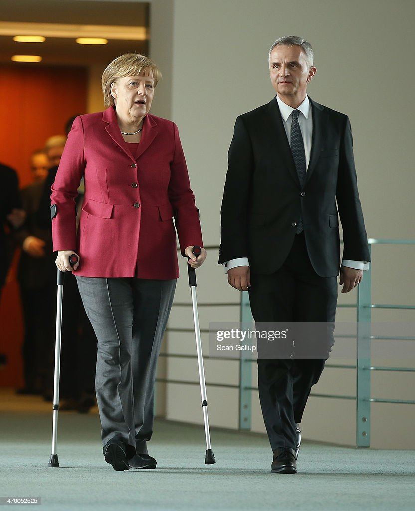 German Chancellor <a gi-track='captionPersonalityLinkClicked' href=/galleries/search?phrase=Angela+Merkel&family=editorial&specificpeople=202161 ng-click='$event.stopPropagation()'>Angela Merkel</a> and Swiss President <a gi-track='captionPersonalityLinkClicked' href=/galleries/search?phrase=Didier+Burkhalter&family=editorial&specificpeople=6269147 ng-click='$event.stopPropagation()'>Didier Burkhalter</a> arrive to speak to the media after talks at the Chancellery on February 18, 2014 in Berlin, Germany. Burkhalter is visiting several EU member state capitals following the recent referendum that will limit immigration to Switzerland, a move that has caused an uproar across the EU and could require the renegotiation of a variety of treaties with Switzerland.