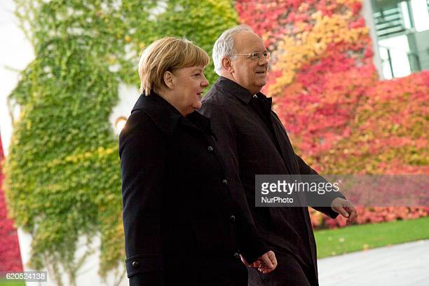 German Chancellor Angela Merkel and Swiss President Johann SchneiderAmmann are pictured after reviewing the guard of honour at the Chancellery in...