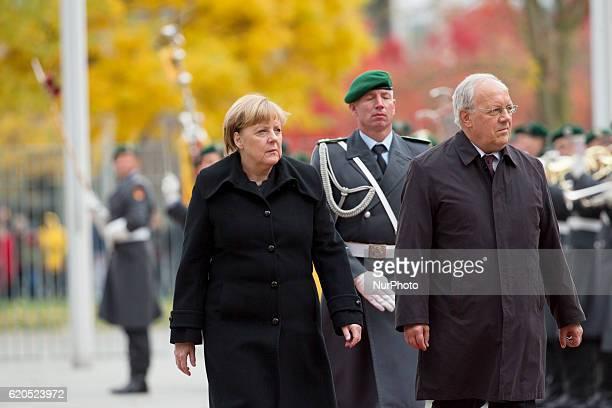 German Chancellor Angela Merkel and Swiss President Johann SchneiderAmmann review the guard of honour at the Chancellery in Berlin on November 2 2016