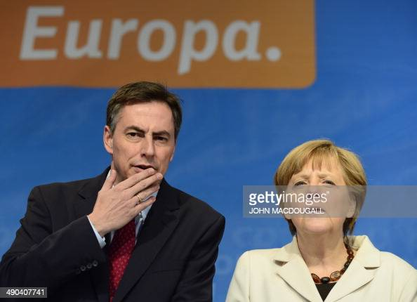 German chancellor Angela Merkel and the Christian Democratic Union frontrunner for the European election David McAllister deliver a speech ahead of...