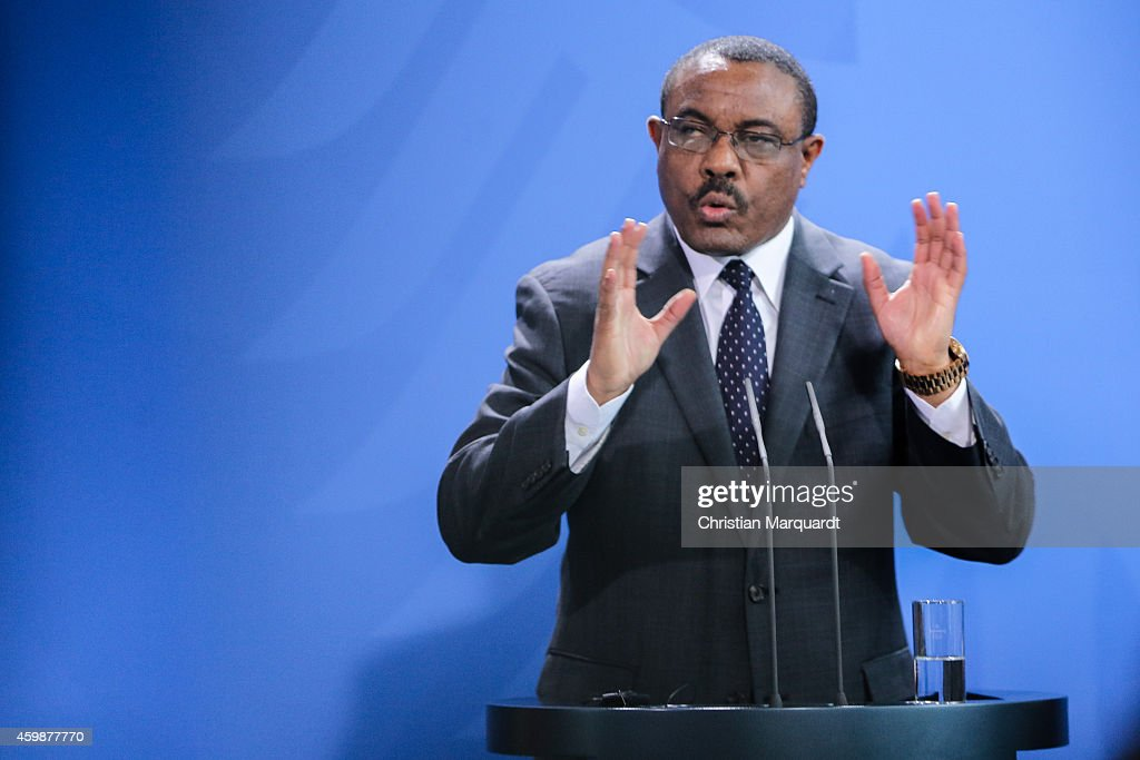 German Chancellor Angela Merkel (unseen) and the Ethiopian Prime Minister <a gi-track='captionPersonalityLinkClicked' href=/galleries/search?phrase=Hailemariam+Desalegn&family=editorial&specificpeople=7752700 ng-click='$event.stopPropagation()'>Hailemariam Desalegn</a> attend a press conference after their meeting at the chancellery on December 03, 2014 in Berlin, Germany. It is the first time that Merkel and Desalegn meet in Berlin.
