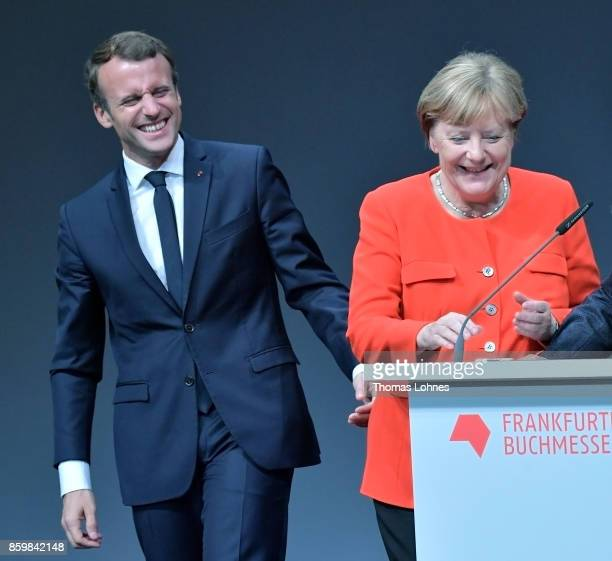 German Chancellor Angela Merkel and the French President Emmanuel Macron react during the opening of the Frankfurt Book Fair 2017 on October 10 2017...