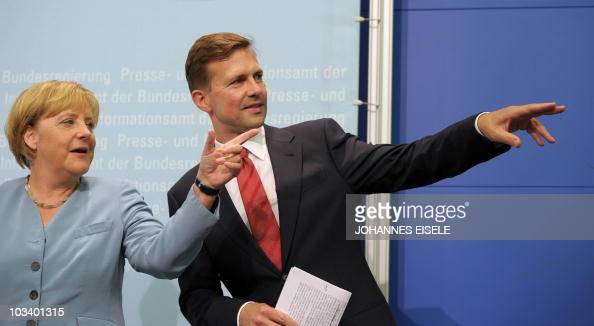 German Chancellor Angela Merkel and the government's new spokesman Steffen Seibert gesture as they address a press conference on August 16 2010 in...