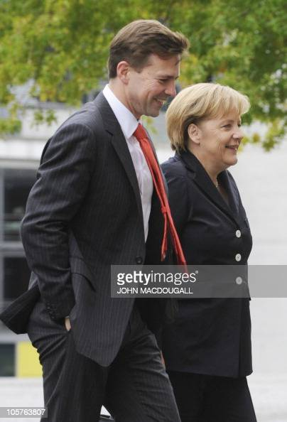 German Chancellor Angela Merkel and the government's spokesman Steffen Seibert arrive for a session of the Bundestag lower house of parliament in...