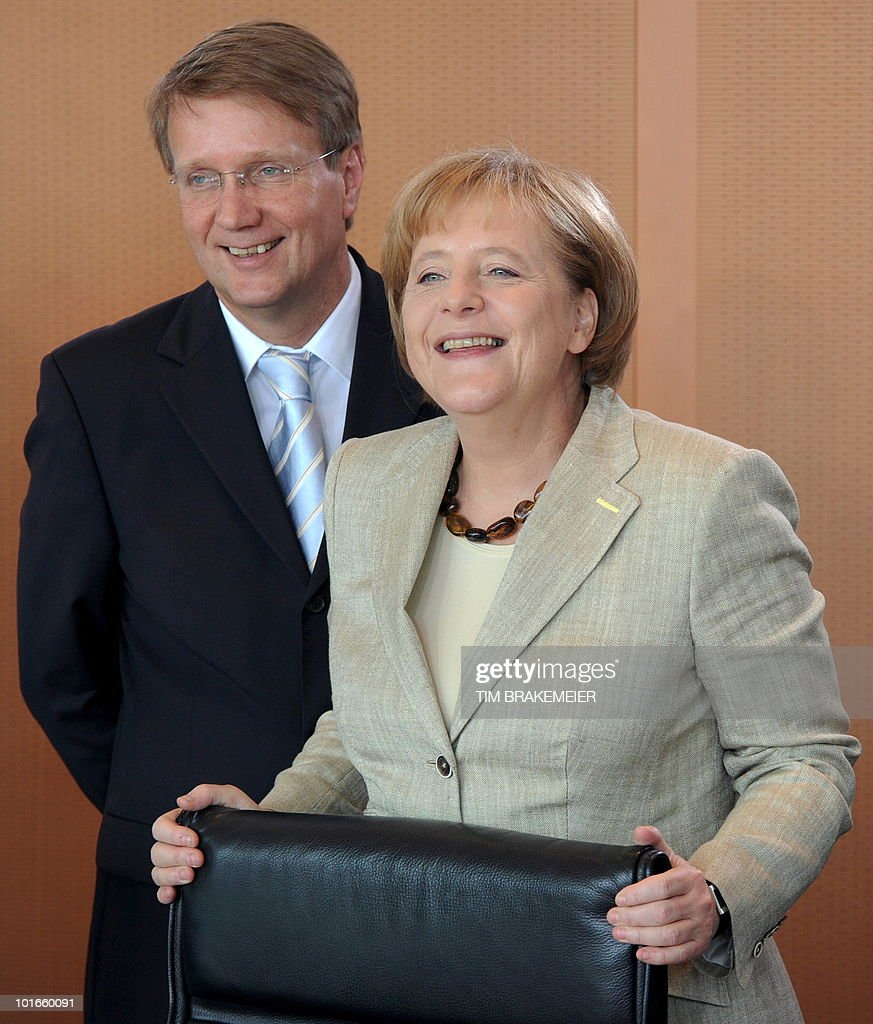 German Chancellor Angela Merkel (R) and the Head of the Chancellery Ronald Pofalla arrive for a retreat with the cabinet on June 6, 2010 at the Chancellery in Berlin. During the two-days conference, Chancellor Merkel and her ministers are preparing a huge package of spending cuts that critics fear could bring the recovery of Europe's top economy to a halt.