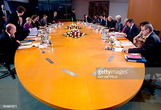 German Chancellor Angela Merkel and the heads of the World Bank the IMF the World Trade Organization and other top institutions have taken their...