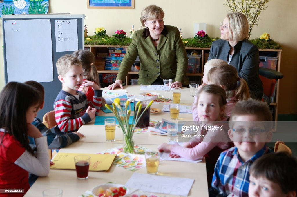 German Chancellor Angela Merkel and the Health Minister Kristin Alheit of Schleswig Holstein chat with kids in a kids parliament during their visit...