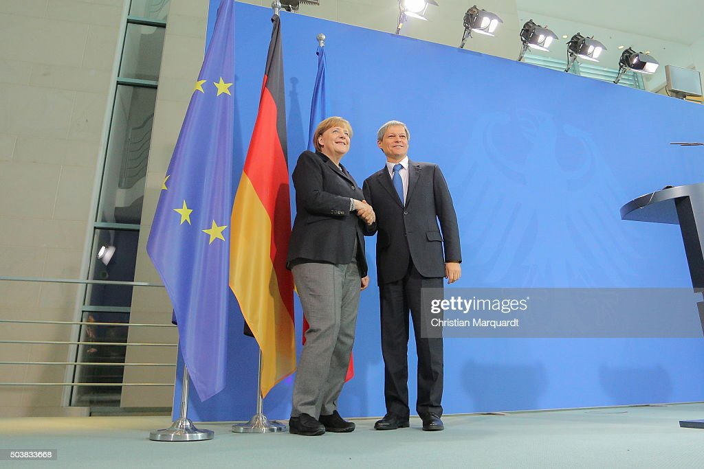 German Chancellor <a gi-track='captionPersonalityLinkClicked' href=/galleries/search?phrase=Angela+Merkel&family=editorial&specificpeople=202161 ng-click='$event.stopPropagation()'>Angela Merkel</a> and the newly elected Romanian Prime Minister Dacian Cioloso talk to the press after their common lunch at the chancellery on January 7, 2016 in Berlin, Germany. Bilateral relations and the European policy on the current refugee situation within Europe were the main topics of their meeting.