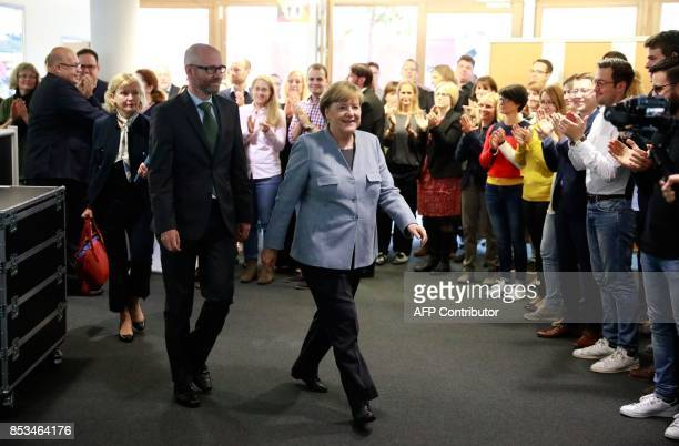 German Chancellor Angela Merkel and the secretary general of her conservative Christian Democratic Union party Peter Tauber arrive for a meeting with...