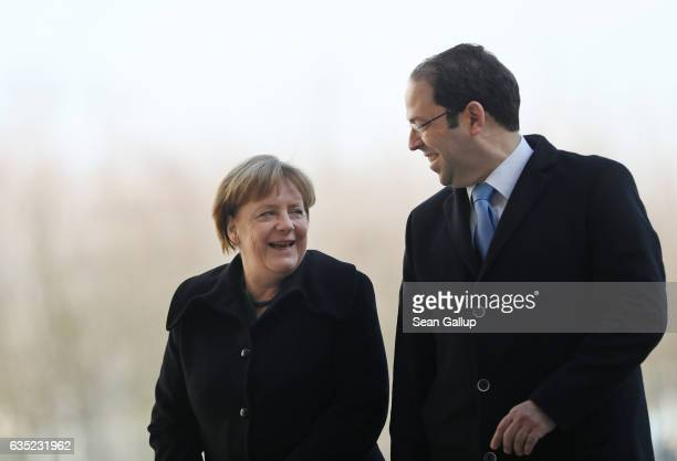 German Chancellor Angela Merkel and Tunisian Prime Minister Youssef Chahed review a gaurd of honor upon Chahed's arrival at the Chancellery on...
