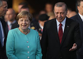 German Chancellor Angela Merkel and Turkish President Recep Tayyip Erdogan arrive to watch NATO military aircraft fly past during the Warsaw NATO...